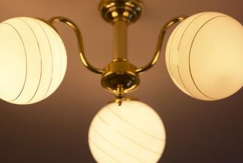 Using a frosted finish paint on your chandelier's globes can make the fixture look more modern.