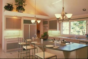 This kitchen design uses a variety of light types to create a pleasant overall effect.