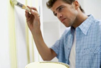 Primer ensures an even, long-lasting paint job on a door.