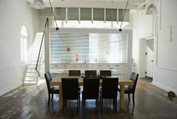 A glass divider helps to separate the space in a studio apartment.