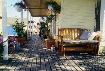 A partially covered deck helps transition from an interior living room to an outdoor space.