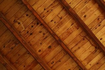 Add faux beams to the ceiling to hide the load-bearing beam amongst them.