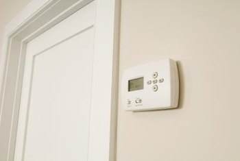 An electronic thermostat can be programmed to help control heating and cooling costs.