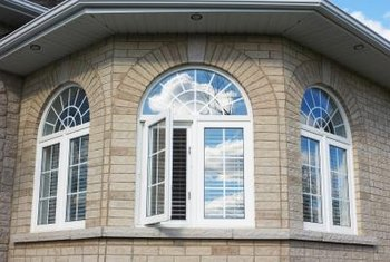 Arched windows enhance your architecture, but they're tricky to dress.