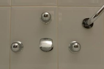 To replace a shower or tub faucet handle, locate the screw that holds it in place.