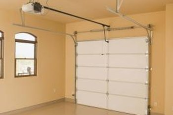 The garage door motor is located on the ceiling.