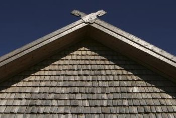 Cedar siding is installed in plank or shingle format.