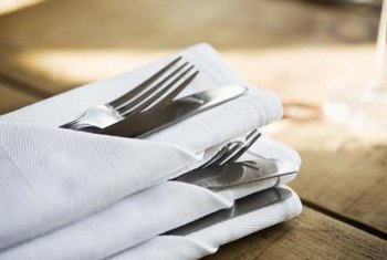 Folded paper napkins make your dinner table look tidier.