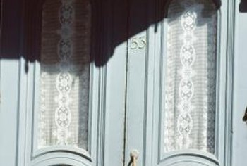 Regardless of a door's construction, curtains make a decorative addition.