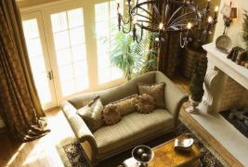 Rich brown curtains enhance a muted green sofa.