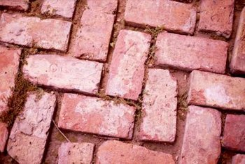 You can use Quikrete products to make concrete pavers that look like real bricks.