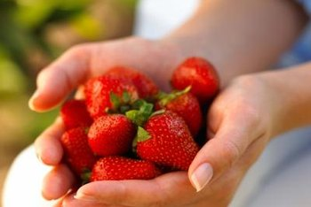 Plant strawberries when the soil is warm, typically in April or May.