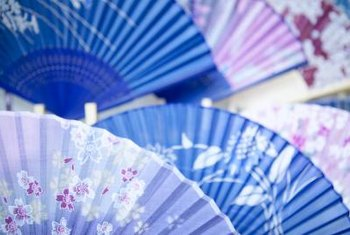 Asian wall fans add color and texture to wall decor.