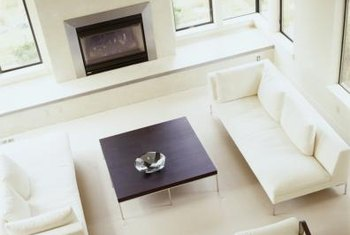 In a spare, small room, a minimalist fireplace helps create a perfect balance.