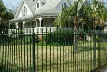 Traditional metal fences are strong, durable and low-maintenance.