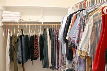 Take full advantage of vertical space in a small walk-in closet.
