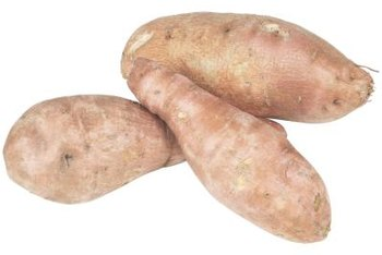 Sweet potatoes have large vines above the ground and tubers underneath the ground.