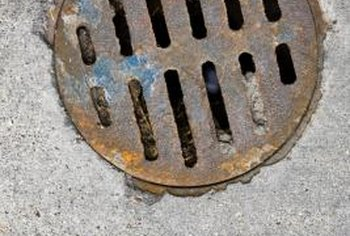 A round drain grate accommodates a relatively small amount of run-off water as compared to a trench drain.