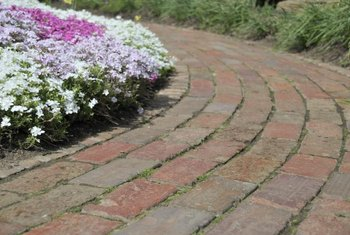 Bricks are often laid in a regular pattern for a garden path.