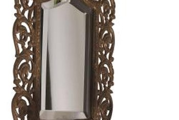 Ornate, vintage mirrors can be worth the time and expense of restoring.
