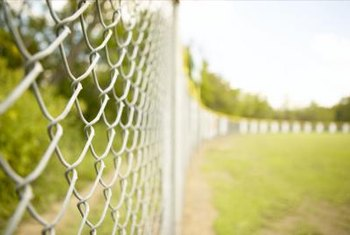 Only refinish chain link fences when rust becomes a problem.