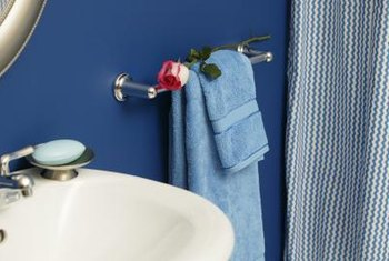 Install new towels and a shower curtain that matches the walls for a fast, easy improvement.