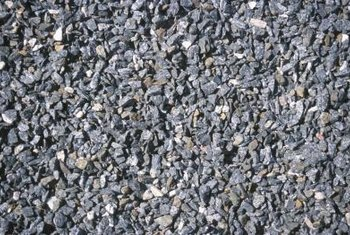 Gravel and crushed stone is an inexpensive paving material for your landscape.