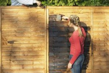 Staining or painting a fence protects the wood.