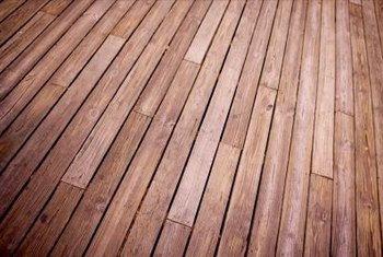 A semi-transparent stain helps blend new boards into an old deck.