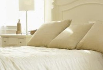 Light colors can make a small apartment bedroom feel more spacious.