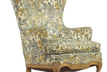 A Classic Wing Chair Is Padded All Over With Curved Front Legs.