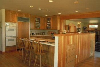 Paneled refrigerators appear built into the cabinets.