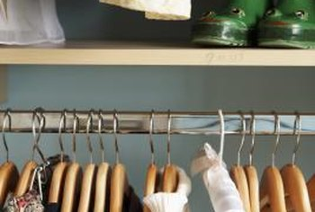 Storage bins, hooks and shelves are must-haves in small closets.