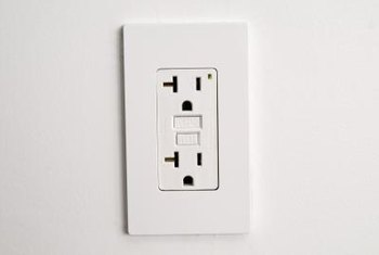 The cover of a wall socket offers little clues to what lies behind the wall.