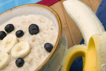 Oatmeal, fruit, nuts and protein powder make a complete Zone breakfast.