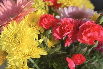 A bouquet of pink carnations and yellow chrysanthemums