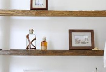 Reclaimed wood shelves adorned with antique store finds exemplify green interior decor.