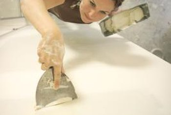 Touch up scrapes and gouges with drywall joint compound after removing the mirrors.
