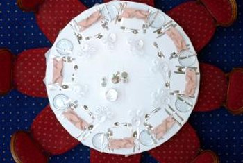 A formal table setting on a round table creates a visually symmetrical display.