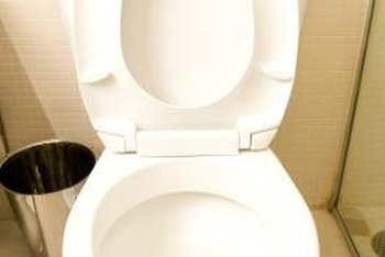 Remove the obstruction to keep the toilet bowl from filling up.