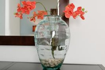 A mirror doubles the impact of vases and flowers.