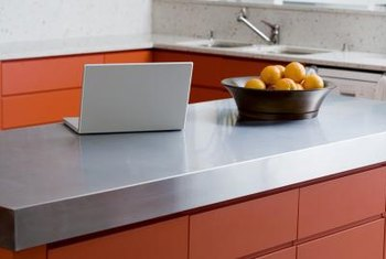 Refinish your existing countertop with the look of stainless steel.