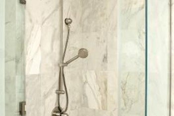 Glass door hinges are common in glass shower enclosures.