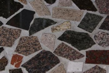 Create pleasing designs with randomly placed bits of ceramic tiles.