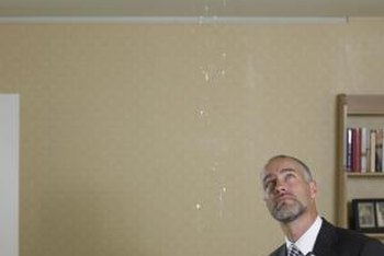 Water damage can cause drop ceiling tiles to warp.
