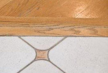Transition strips cover the gap between hardwood flooring and tile.