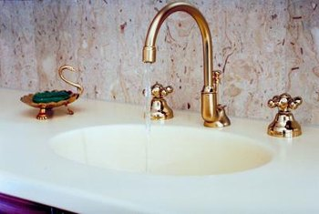White alabaster lends an air of distinction to sinks and other fixtures.