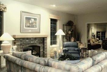 Hanging a large painting or mirror over your fireplace can help.