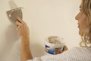 Use premixed joint compound for easy drywall repair.