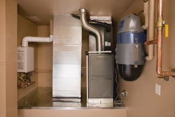A furnace connects to ducts that push air through interior vents.